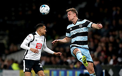 Matt Smith of Queens Park Rangers heads the ball past Marcus Olsson of Derby County - Mandatory by-line: Robbie Stephenson/JMP - 31/03/2017 - FOOTBALL - iPro Stadium - Derby, England - Derby County v Queens Park Rangers - Sky Bet Championship
