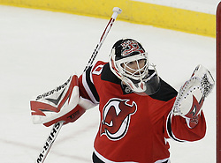 Dec 30, 2009; Newark, NJ, USA; New Jersey Devils goalie Martin Brodeur (30) makes a glove save on Pittsburgh Penguins center Sidney Crosby (87) during the third period at the Prudential Center. The Devils defeated the Penguins 2-0.