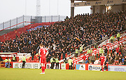 The ;rage Dundee support celebrate after Gary Harkins had put Dundee 3-1 ahead -  Aberdeen v Dundee, SPFL Premiership at Pittodrie<br />