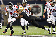 NEW ORLEANS, LA - DECEMBER 26:   Jason Snelling #44 of the Atlanta Falcons is hit by Jonathan Vilma #51 of the New Orleans Saints at Mercedes-Benz Superdome on December 26, 2011 in New Orleans, Louisiana.  The Saints defeated the Falcons 45-16.  (Photo by Wesley Hitt/Getty Images) *** Local Caption *** Jason Snelling; Jonathan Vilma