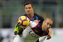 February 3, 2019 - Milan, Milan, Italy - Rodrigo Palacio #24 of Bologna FC competes for the ball with Cedric Soares #21 of FC Internazionale Milano during the serie A match between FC Internazionale and Bologna FC at Stadio Giuseppe Meazza on February 3, 2019 in Milan, Italy. (Credit Image: © Giuseppe Cottini/NurPhoto via ZUMA Press)