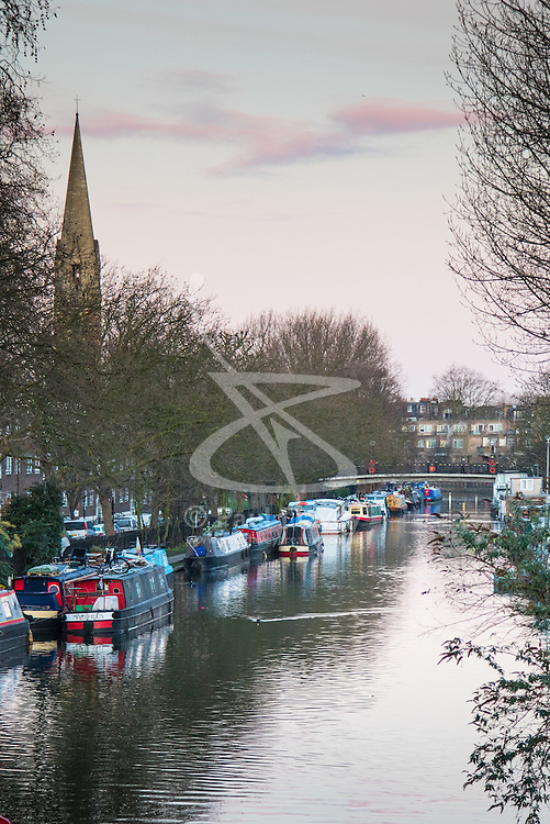 Little Venice, London, February 19th 2016. Houseboats moored on the Grand Union Canal as the sun rises on a clear, cold February morning. &copy;Paul Davey<br /> FOR LICENCING CONTACT: Paul Davey +44 (0) 7966 016 296 paul@pauldaveycreative.co.uk