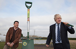 "© Licensed to London News Pictures. 23/02/2012. Wallington, Surrey. L-R: Seb Coe and Boris Johnson in front of the world's biggest spade. The Mayor of London, Boris Johnson and LOCOG Chairman Sebastian Coe today, 23 February 2012, showed off the benefits of urban food growing as they launched ""The Big Dig"" volunteer gardening weekend (16-17 March). This is all in support of Capital Growth, a scheme to create 2,012 community food growing spaces by the end of 2012.  Photo credit: Bettina Strenske/LNP"