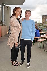 ADWOA ABOAH and FELIX COOPER at a supper and screening of 'No More Tiaras' a film by Mary Nighy held at Shrimpy's, King's Cross Filling Station, Goods Way, London on 7th May 2014.