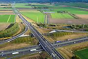 Nederland, Noord-Brabant, Gemeente Moerdijk, 23-10-2013; Infrabundel, combinatie van autosnelweg A16 gebundeld met de spoorlijn van de HSL ter hoogte van Knooppunt Zonzeel. Goederentrein op de reguliere spoorlijn.<br /> Combination of motorway A16 and the HST railroad, Brabant (southern Netherlands)<br /> luchtfoto (toeslag op standard tarieven);<br /> aerial photo (additional fee required);<br /> copyright foto/photo Siebe Swart