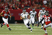 ATLANTA, GA - JANUARY 13: Russell Wilson #3 of the Seattle Seahawks runs with the ball against the Atlanta Falcons during the NFC Divisional Playoff Game at Georgia Dome on January 13, 2013 in Atlanta, Georgia. The Falcons defeated the Seahawks 30-28. (Photo by Joe Robbins) *** Local Caption *** Russell Wilson