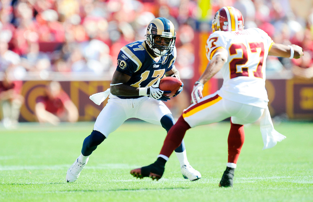 LANDOVER, MD - OCTOBER 12: Donnie Avery #17 of the St. Louis Rams runs with the ball as Fred Smoot #27 of the Washington Redskins defends at FedEx Field on October 12, 2008 in Landover, Maryland. The Rams defeated the Redskins 19-17.(Photo by Rob Tringali/Sportschrome/ Images) *** Local Caption *** Donnie Avery