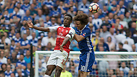 Football - 2017 FA Cup Final - Arsenal vs. Chelsea<br /> <br /> Fikayo Tomori of Chelsea ans Danny Welbeck of Arsenal compete for the header at Wembley.<br /> <br /> COLORSPORT/DANIEL BEARHAM