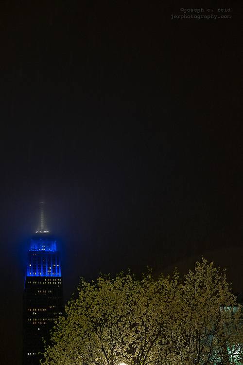 Empire State Building lit in blue and white colors of Dodgers in honor of Jackie Robinson Day, April 15, 2014, New York, NY, US