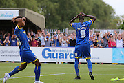 Tom Elliott of AFC Wimbledon and Lyle Taylor of AFC Wimbledon show there reaction during the Sky Bet League 2 match between AFC Wimbledon and Plymouth Argyle at the Cherry Red Records Stadium, Kingston, England on 8 August 2015. Photo by Stuart Butcher.