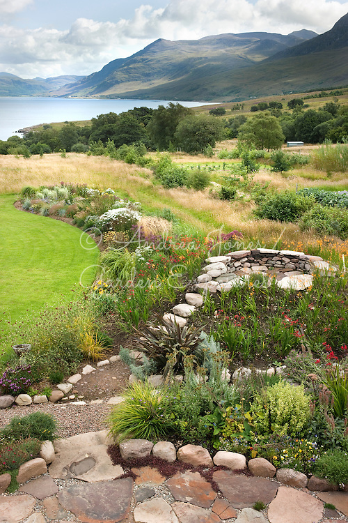 Raised herbaceous borders, stone outlook, mown lawn and meadow with view to Little Loch Broom<br /> <br /> 2 Durnamuck, Little Loch Broom, Wester Ross, Scotland
