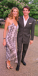 Model ELLE MACPHERSON and MR TIM JEFFERIES, at a party in London on 7th July 1999.MUC 49