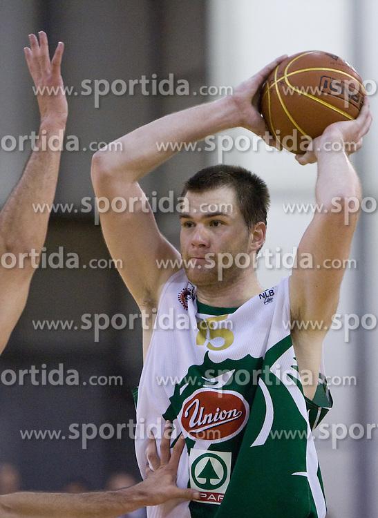 Uros Slokar (15) of Olimpija at basketball match of 4th Round of NLB League between KK Union Olimpija and KK Crvena zvezda,  on October 24, 2009, Arena Tivoli, Ljubljana, Slovenia.  Union Olimpija won 94:76.  (Photo by Vid Ponikvar / Sportida)