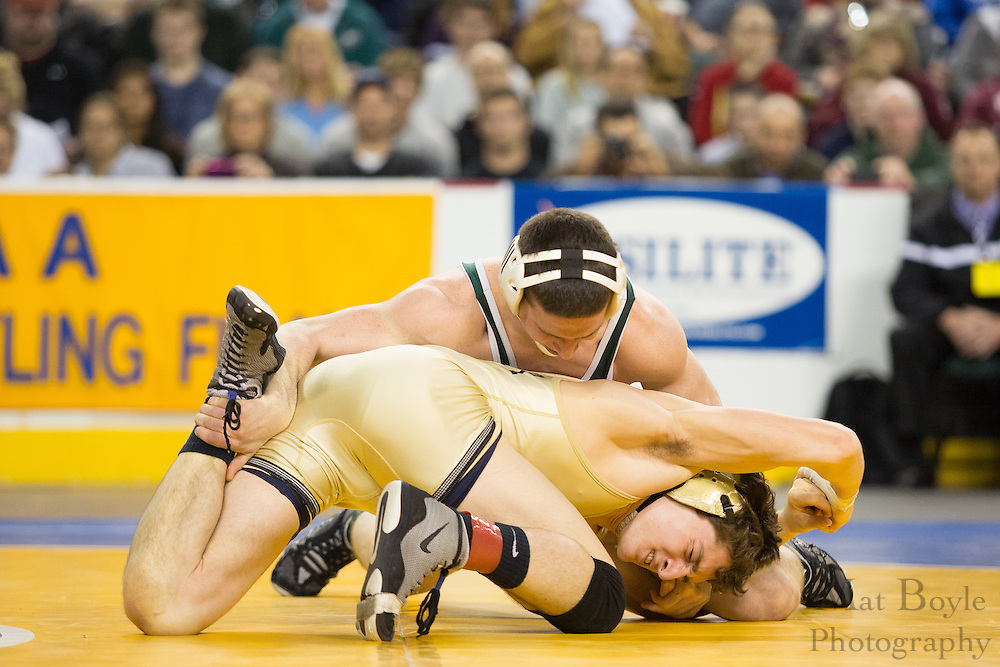 Jonathan Schleifer of East Brunswick is defeated by Dillon Artigliere of Roxbury (Yellow) during the 160 lb NJ individual state wrestling final held at Boardwalk Hall in Atlantic City on Sunday March 9, 2013. (photo / Mat Boyl