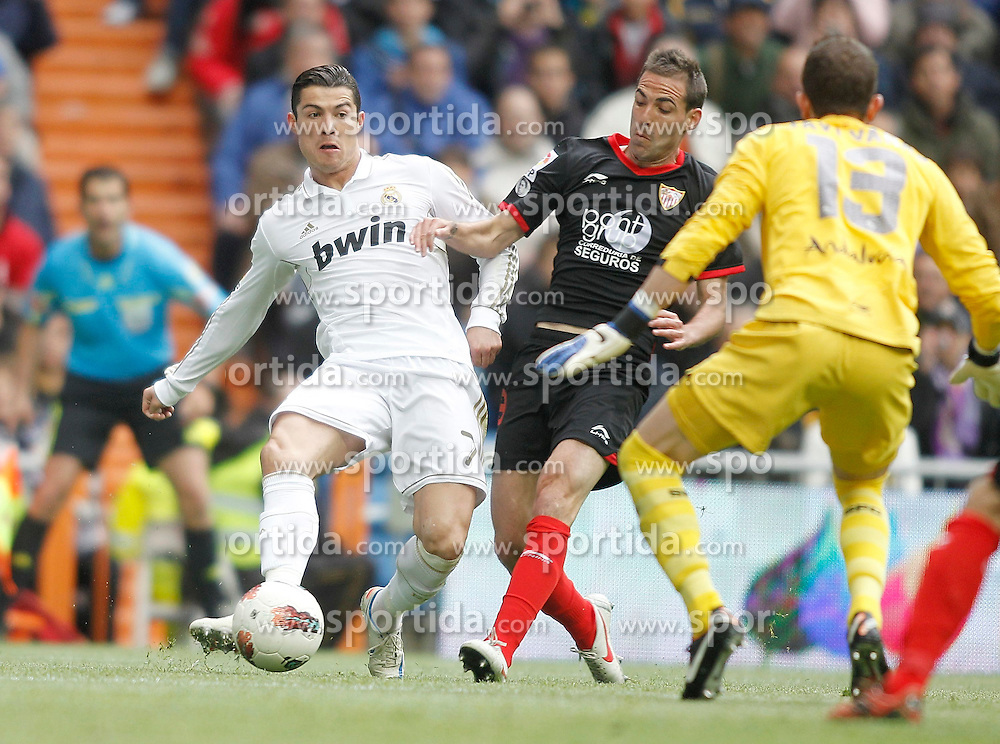 29.04.2012, Santiago Bernabeu Stadion, Madrid, ESP, Primera Division, Real Madrid vs FC Sevilla, 36. Spieltag, im Bild Real Madrid's Cristiano Ronaldo against Sevilla's Fernando Navarro the football match of spanish 'primera divison' league, 36th round, between Real Madrid and FC Sevilla at Santiago Bernabeu stadium, Madrid, Spain on 2012/04/29. EXPA Pictures © 2012, PhotoCredit: EXPA/ Alterphotos/ Alvaro Hernandez..***** ATTENTION - OUT OF ESP and SUI *****