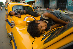 Kolkata's (Calcutta) poorest residents begin to wake around 5 am on the streets of central Calcutta around Sudder Street August 30, 2007. This congested city was the first city of the colonial British and  now it is the only city of India where hand pulled rickshaws are still being pulled. In 1996, the Government of West Bengal announced that it was intending to ban the rickshaws to relieve traffic congestion  but it never was fully enforced. In 2007, the government again pushed to have the ban enforced and a case is currently being decided in the Supreme court that will determine the outcome for the hand pulled rickshaws.