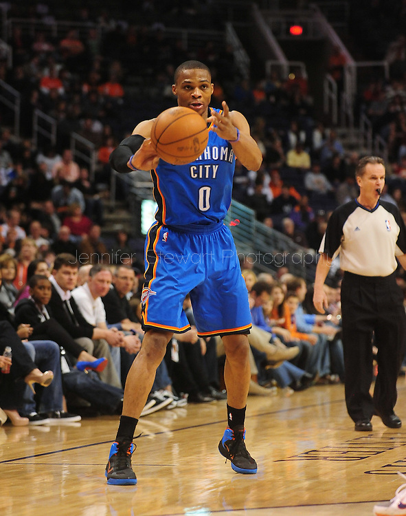 Feb. 4, 2011; Phoenix, AZ, USA; Oklahoma City Thunder guard Russell Westbrook (0) reacts on the court against the Phoenix Suns at the US Airways Center. The Thunder defeated the Suns 111-107. Mandatory Credit: Jennifer Stewart-US PRESSWIRE