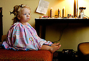 Braelyn, 2, waits to have her makeup finished and hair done in her stylists' Lafayette hotel room before a local beauty pageant.