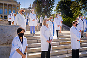 01 AUGUST 2020 - DES MOINES, IOWA: Dr. ROSSANA ROSA, left, and other doctors at the Iowa State Capitol Saturday. About 50 doctors, medical professionals, and public health professionals from across Iowa came to the State Capitol to demand that Iowa Governor Kim Reynolds impose a mask mandate to control the spread of the coronavirus (SARS-CoV-2). Despite the continued spread of the coronavirus and rapidly increasing infection rate for COVID-19, the Governor has refused to impose a mask mandate or close businesses. For the week ending Saturday, Aug. 1, Iowa reported new 2,736 new cases of COVID-19.             PHOTO BY JACK KURTZ