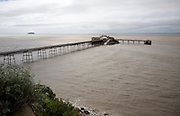 Birnbeck Pier in the Bristol Channel at Weston super Mare, Somerset, England with Flat Holm and Steep Holm islands in the distance