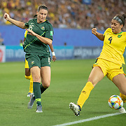 GRENOBLE, FRANCE June 18.  Emily Gielnik #15 of Australia puts in a cross defence by Chantelle Swaby #4 of Jamaica during the Jamaica V Australia, Group C match at the FIFA Women's World Cup at Stade des Alpes on June 18th 2019 in Grenoble, France. (Photo by Tim Clayton/Corbis via Getty Images)