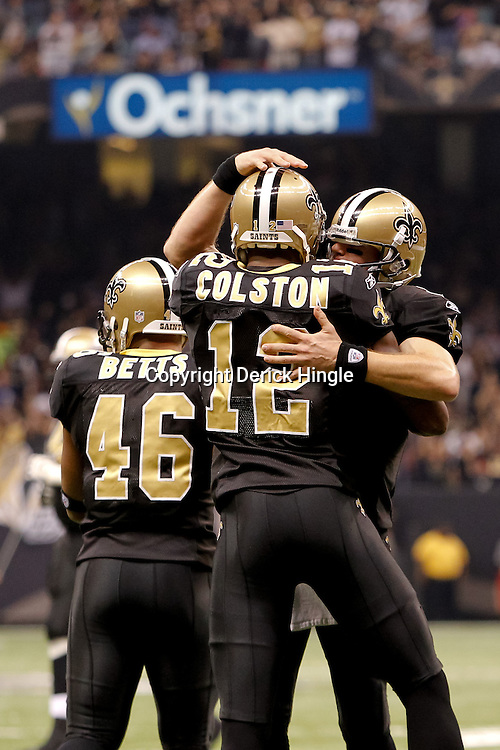 November 21, 2010; New Orleans, LA, USA; New Orleans Saints quarterback Drew Brees (9) celebrates with wide receiver Marques Colston (12) following a touchdown during the first half against the Seattle Seahawks at the Louisiana Superdome. Mandatory Credit: Derick E. Hingle