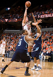 Virginia forward Laurynas Mikalauskas (11) shoots a hook shot against ODU.  The Virginia Cavaliers men's basketball team faced the Old Dominion Monarch in the second round of the College Basketball Invitational (CBI) at the University of Virginia's John Paul Jones Arena in Charlottesville, VA on March 24, 2008.