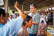03 NOVEMBER 2012 - HAT YAI, SONGKHLA, THAILAND: People gamble on bullfights at the bullfighting arena in Hat Yai, Songkhla, Thailand. Bullfighting is a popular past time in southern Thailand. Hat Yai is the center of Thailand's bullfighting culture. In Thai bullfights, two bulls are placed in an arena and they fight, usually by head butting each other until one runs away or time is called. Huge amounts of mony are wagered on Thai bullfights - sometimes as much as 2,000,000 Thai Baht ($65,000 US).       PHOTO BY JACK KURTZ