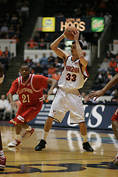 Jason Cain (33) controls the ball against Hartford.  Cain scored 7 points as the Hoos beat the Hawks 71-62...The Virginia Cavaliers defeated Hartford 71-62 at University Hall in Charlottesville, VA on December 31, 2005.