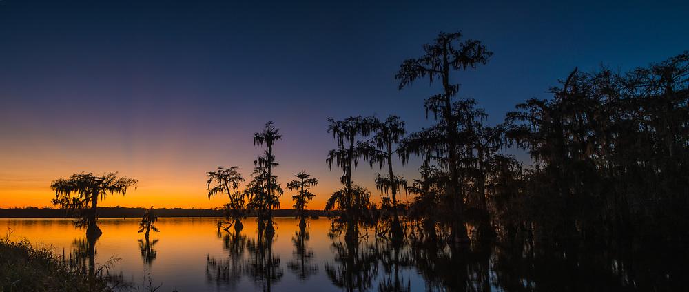Lake Martin panoramic photograph of a intense sunset.