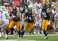 September 3, 2011: Iowa Hawkeyes defensive lineman Lebron Daniel (58) and Iowa Hawkeyes linebacker Christian Kirksey (20) provide some blocking for Iowa Hawkeyes linebacker James Morris (44) after an interception during the first half of the game between the Tennessee Tech Golden Eagles and the Iowa Hawkeyes at Kinnick Stadium in Iowa City, Iowa on Saturday, September 3, 2011. Iowa defeated Tennessee Tech 34-7 in a game stopped at one point due to lightning and rain.