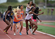 Diona Griffith takes the handoff from Rachel Glenn on the anchor leg ofthe Long Beach Wilson girls 4 x 400m relay that placed fourth in 3:45.98 during the 2019 CIF Southern Section Masters Meet in Torrance, Calif., Saturday, May 18, 2019.