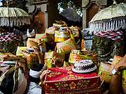 "02 AUGUST 2017 - UBUD, BALI, INDONESIA: Women file into the temple during the ""Merchants' Day"" ceremony at the Pura (Temple) Melanting Pasar Ubud, the small Hindu temple in the Ubud market. It's a day that merchants throughout Ubud come to the temple to make offerings and pray for prosperity.    PHOTO BY JACK KURTZ"