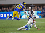 Jan 12, 2019; Los Angeles, CA, USA; Dallas Cowboys quarterback Dak Prescott (4) looks to avoid the tackle from Los Angeles offensive linebacker Samson Ebukam (50) during an NFL divisional playoff game at the Los Angeles Coliseum. The Rams beat the Cowboys 30-22. (Kim Hukari/Image of Sport)