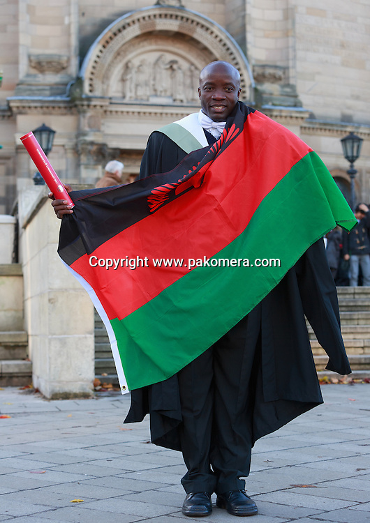 29th November, Edinburgh. UK. Photocall Malawian doctor celebrates first online teaching graduation. A surgeon from Malawi Dr Lughano Kalongolera spent last three years studying for a MSc in Surgical Sciences from the University of Edinburgh.<br /> <br /> Photos by Pako Mera