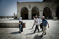 JERUSALEM : Orthodox Jewish men make a tour of the Temple Mount or Al-Aqsa Mosque Compound the holy site for Judaism and the Islam in Israeli annexed east Jerusalem's old City April 01, 2010.