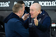 Queens Park Rangers manager Mark Warburton (R) greets Swansea City manager Steve Cooper ahead of the EFL Sky Bet Championship match between Swansea City and Queens Park Rangers at the Liberty Stadium, Swansea, Wales on 11 February 2020.