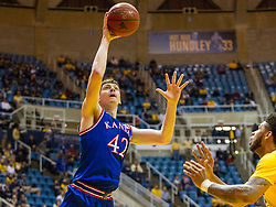 Jan 12, 2016; Morgantown, WV, USA; Kansas Jayhawks forward Hunter Mickelson (42) shoots under the basket during the first half against the West Virginia Mountaineers at the WVU Coliseum. Mandatory Credit: Ben Queen-USA TODAY Sports