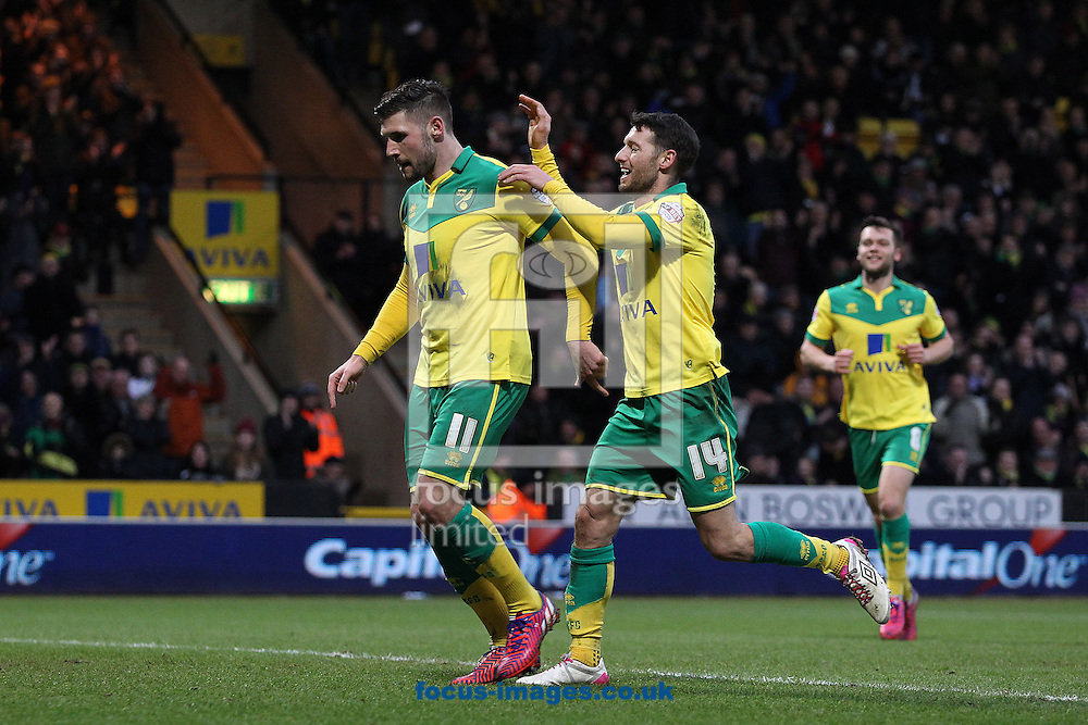 Gary Hooper of Norwich celebrates scoring his sides 3rd goal from the penalty spot and completing his hat trick during the Sky Bet Championship match at Carrow Road, Norwich<br /> Picture by Paul Chesterton/Focus Images Ltd +44 7904 640267<br /> 07/02/2015