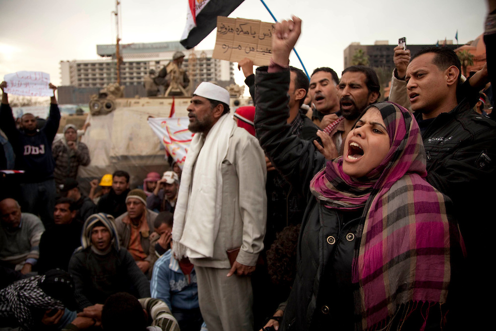 Anti-government protesters gather in Tahrir Square in Cairo, Egypt, on Monday, Feb. 7, 2011. Protesters gathered around army vehicles to prevent the army from moving towards the square and installing barbed wires.