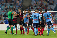 SYDNEY, AUSTRALIA - APRIL 13: Match referee Shaun Evans argues with wanderers players Western Sydney Wanderers forward Oriol Riera (9), Western Sydney Wanderers midfielder Rashid Mahazi (22) and Western Sydney Wanderers defender Raul Llorente (24) at round 25 of the Hyundai A-League Soccer between Western Sydney Wanderers and Sydney FC  on April 13, 2019 at ANZ Stadium in Sydney, Australia. (Photo by Speed Media/Icon Sportswire)