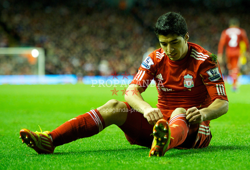 LIVERPOOL, ENGLAND - Boxing Day Monday, December 26, 2011: Liverpool's Luis Alberto Suarez Diaz looks dejected during the 1-1 Premiership draw with Blackburn Rovers at Anfield. (Pic by David Rawcliffe/Propaganda)
