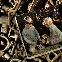 An old photo of a young boy and girl in a box of nuts and bolts