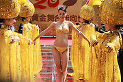 HANGZHOU, CHINA - MAY 18: (CHINA OUT) <br /> <br /> A model (C) in  gold underwear walks on stage during a companys anniversary celebration on May 18, 2016 in Hangzhou, Zhejiang Province of China. This pair of underwear on model is of much value and the stage under glass is gathered with 666 gold bullion. <br /> ©Exclusivepix Media