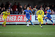 AFC Wimbledon midfielder Mitchell (Mitch) Pinnock (11) dribbling and about to take on Fleetwood Town midfielder Glenn Whelan (12) during the EFL Sky Bet League 1 match between AFC Wimbledon and Fleetwood Town at the Cherry Red Records Stadium, Kingston, England on 8 February 2020.