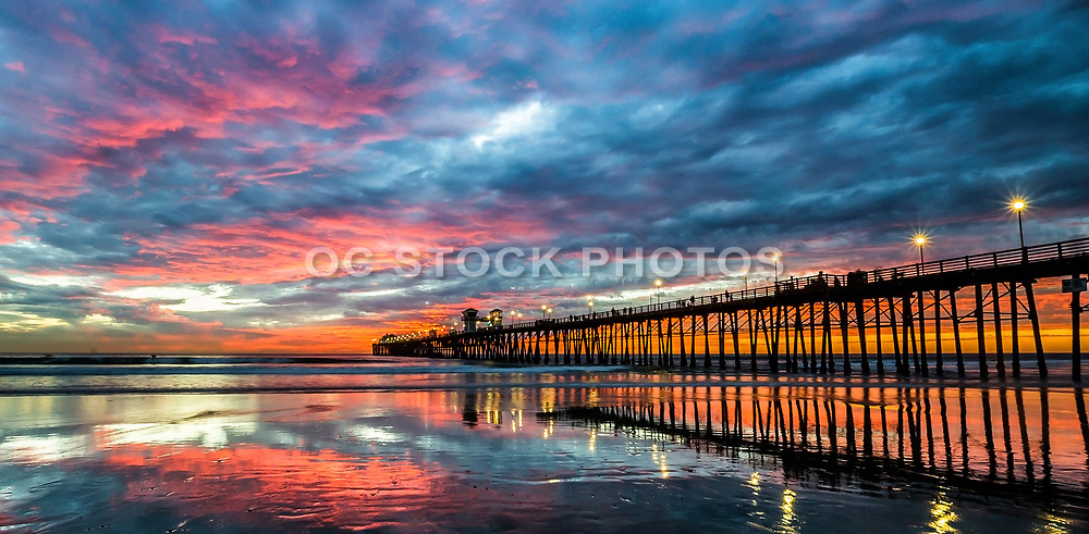 Vivid Sunset Reflections At Oceanside Pier