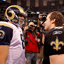 December 12, 2010; New Orleans, LA, USA; New Orleans Saints quarterback Drew Brees (9) talks with St. Louis Rams quarterback Sam Bradford (8) following a game at the Louisiana Superdome. The Saints defeated the Rams 31-13. Mandatory Credit: Derick E. Hingle-US PRESSWIRE