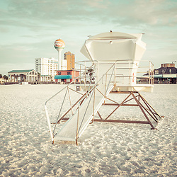 Pensacola Beach Florida lifeguard tower 2 retro photo with Casino Beach and the beach ball water tower. Pensacola Beach is on Santa Rosa Island in the Emerald Coast area of the Southeastern United States of America. Photo is high resolution. Copyright ⓒ 2018 Paul Velgos with All Rights Reserved.