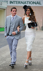 LIVERPOOL, ENGLAND - Friday, April 4, 2014: Racegoers during Ladies' Day on Day Two of the Aintree Grand National Festival at Aintree Racecourse. (Pic by David Rawcliffe/Propaganda)