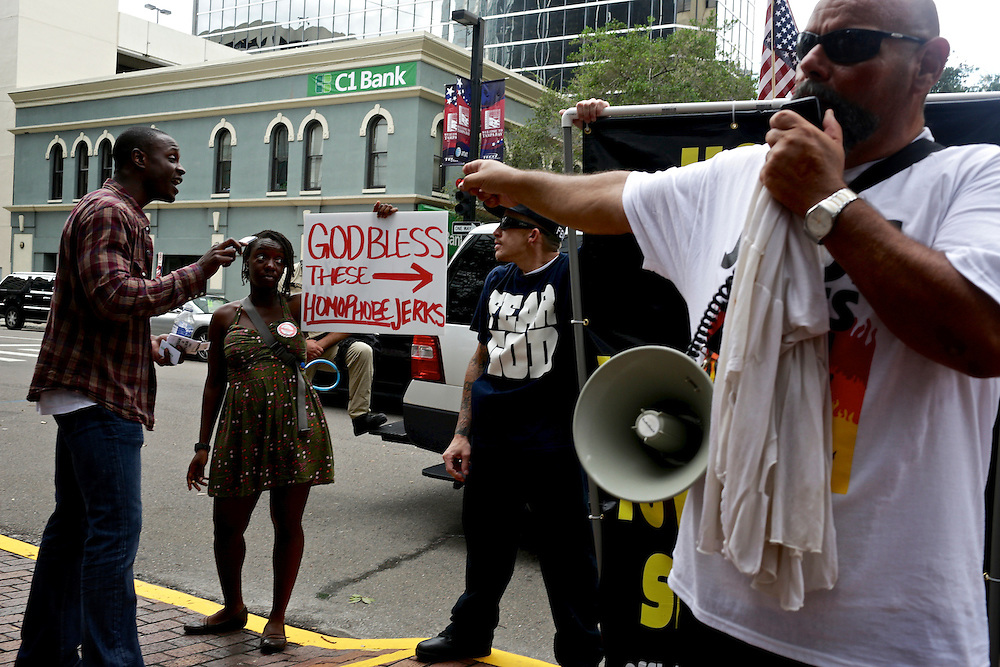 Members of the Official Street Preachers argue with passers-by near the Tampa Bay Times Forum during the 2012 Republican National Convention in Tampa, Fla. on Aug. 29, 2012.